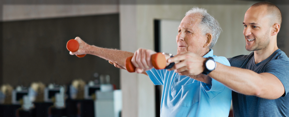 A resident receiving compassionate care during a rehab therapy session